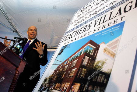 Cory A. Booker Graph, Newark Mayor Cory A. Booker gestures as he speaks near an artist's rendering during groundbreaking ceremonies for the Teachers Village development in downtown Newark, N.J. Officials in New Jersey's largest city hope that the development of sleek new apartments just for teachers will help them improve education. But some educators are skeptical the village will attract and keep the residents being sought