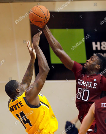 Micheal Eric, Devon White Temple's Micheal Eric (50) blocks a shot by La Salle's Devon White (14) during the second half of an NCAA college basketball game, in Philadelphia. Temple won 80-79 in overtime