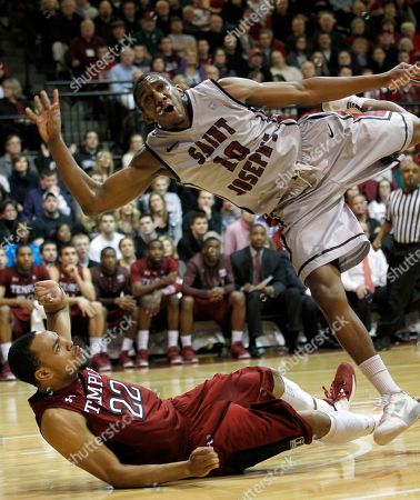 Langston Galloway, Aaron Brow Saint Joseph's guard Langston Galloway (10) runs into Temple guard Aaron Brown (22) as he shoots during the first half of an NCAA basketball game in Philadelphia. St. Joseph's won 82-72