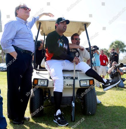 Jeffrey Loria, Ozzie Guillen Miami Marlins manager Ozzie Guillen, center, sits on a golf cart and watches pitchers throw along side Marlins owner Jeffrey Loria, left, during spring training baseball in Jupiter, Fla. Loria's once drew complaints from the players' union for his meager payrolls, but the Marlins were big spenders last offseason. They swung deals totaling $191 million to acquire NL batting champion Jose Reyes, All-Star left-hander Mark Buehrle and All-Star closer Heath Bell