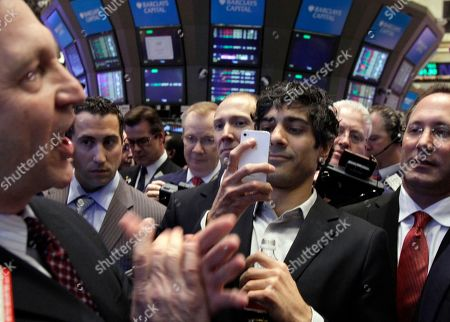 Jeremy Stoppelman, Thomas Facchine Jeremy Stoppelman, second from right, Yelp co-founder and CEO, uses his mobile phone to photograph specialist Thomas Facchine, left, as he calls out prices during Yelp's IPO on the floor of the New York Stock Exchange . Yelp's stock is soaring in its stock market debut Friday. The shares are up 61 percent to $24.15 in the first minutes of trading, after pricing at $15 on Thursday night