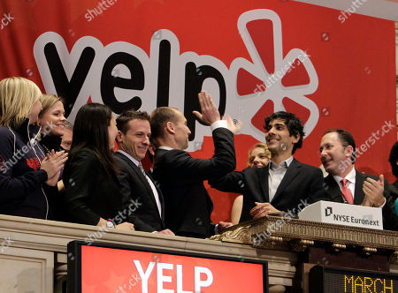 Jeremy Stoppelman Jeremy Stoppelman, second from right, Yelp co-founder and CEO, gets a high-five during opening bell ceremonies of the New York Stock Exchange . Yelp's stock is soaring in its stock market debut Friday. The shares are up 61 percent to $24.15 in the first minutes of trading, after pricing at $15 on Thursday night