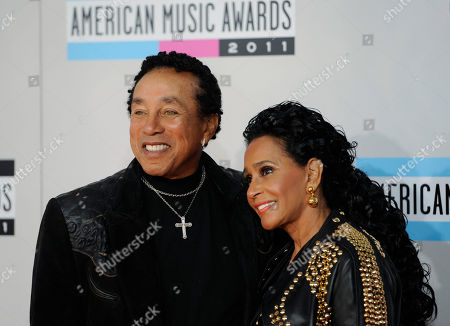 Smokey Robinson, Frances Gladney Smokey Robinson, left, and wife Frances Gladney arrive at the 39th Annual American Music Awards on in Los Angeles