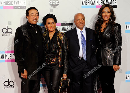 Smokey Robinson, Frances Gladney, Berry Gordy From left, Smokey Robinson, wife Frances Gladney, and Berry Gordy arrive at the 39th Annual American Music Awards on in Los Angeles
