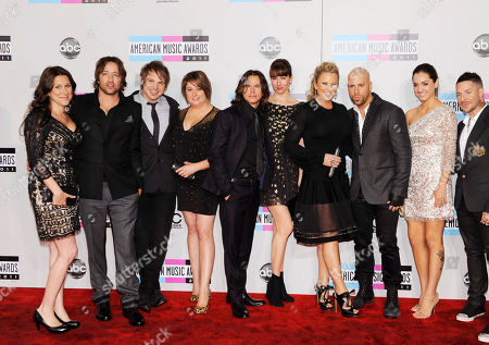 Stock Picture of Brian Craddock, Robin Diaz, Chris Daughtry, Josh Paul, Josh Steely From left, Mary Steely, musician Josh Steely of Daughtry, musician Brian Craddock of Daughtry, Holli Craddock, musician Robin Diaz of Daughtry, Lisa Diaz, Deanna Daughtry, musician Chris Daughtry of Daughtry, Kara Paul, and musician Josh Paul of Daughtry arrive at the 39th Annual American Music Awards on in Los Angeles