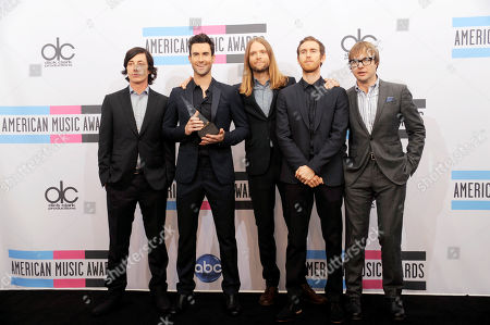 Matt Flynn, Adam Levine, James Valentine, Jesse Carmichael, Mickey Madden The band Maroon 5, from left, Matt Flynn, Adam Levine, James Valentine, Jesse Carmichael, and Mickey Madden pose backstage with the award for pop/rock favorite band duo or group at the 39th Annual American Music Awards on in Los Angeles