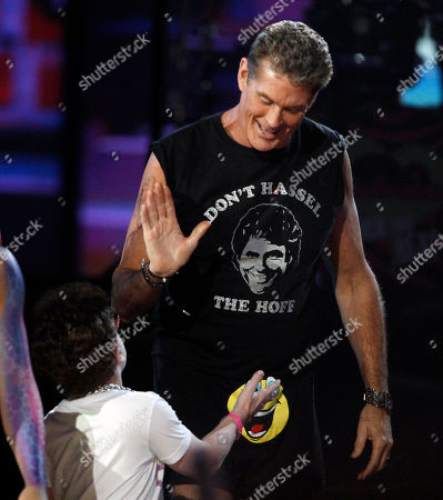 David Hasselhoff, Keenan Cahill David Hasselhoff and Keenan Cahill are seen onstage while LMFAO perform at the 39th Annual American Music Awards on in Los Angeles