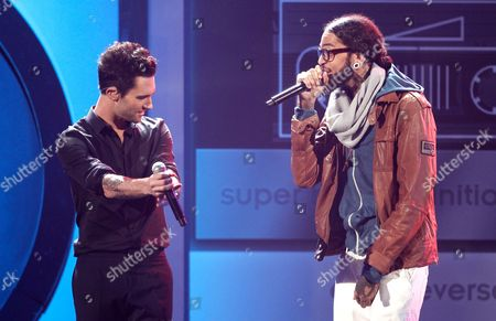 Adam Levine, Travis McCoy Adam Levine, left, the band Maroon 5, Travis McCoy, and Gym Class Heroes perform at the 39th Annual American Music Awards on in Los Angeles