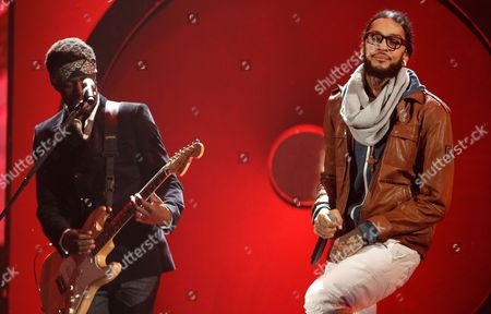 Travis McCoy Travis McCoy, right, and Gym Class Heroes perform onstage with Maroon 5 at the 39th Annual American Music Awards on in Los Angeles