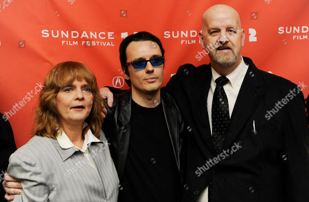 "Damien Echols, center, a producer of the film ""West of Memphis,"" poses with Pam Hobbs, left, and Mark Byers at the premiere of the documentary film at the 2012 Sundance Film Festival in Park City, Utah, . Echols spent 18 years on death row in Arkansas after being accused, along with Jason Baldwin and Jessie Misskelley Jr., of the 1993 murders of three eight-year-old boys including Byers' son Christopher and Hobbs' son Stevie. In August 2011 the three men were released from prison after entering a plea that allowed them to maintain their innocence, while acknowleding that prosecutors had enough evidence to convict them"