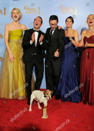 """Missy Pyle, Jean Dujardin, Uggie, Michel Hazanavicius, Berenice Bejo, Penelope Ann Miller The cast and crew of the film """"The Artist"""" pose backstage with the award for Best Motion Picture - Comedy or Musical during the 69th Annual Golden Globe Awards, in Los Angeles. From left, Missy Pyle, Jean Dujardin, Uggie, Michel Hazanavicius, Berenice Bejo and Penelope Ann Miller"""