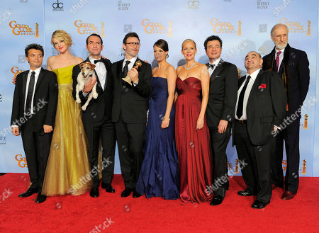 """Thomas Langmann, Missy Pyle, Jean Dujardin, Michel Hazanavicius, Berenice Bejo, Penelope Ann Miller, Ludovic Bource, Ken Davitian, James Cromwell The cast and crew of the film """"The Artist"""" pose backstage with the award for Best Motion Picture - Comedy or Musical during the 69th Annual Golden Globe Awards, in Los Angeles. From left, Thomas Langmann, Missy Pyle, Jean Dujardin, Michel Hazanavicius, Berenice Bejo, Penelope Ann Miller, Ludovic Bource, Ken Davitian and James Cromwell"""