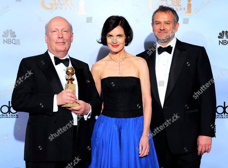 """Stock Image of Julian Fellows, Elizabeth McGovern, Hugh Bonneville Julian Fellows, left, Elizabeth McGovern and Hugh Bonneville pose backstage with the award for Best Mini-Series or Motion Picture Made for Television for """"Downtown Abbey"""" during the 69th Annual Golden Globe Awards, in Los Angeles"""