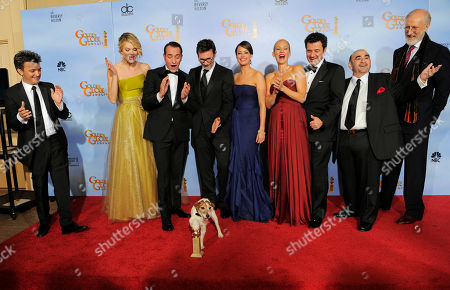 """Thomas Langmann, Missy Pyle, Jean Dujardin, Uggie, Michel Hazanavicius, Berenice Bejo, Penelope Ann Miller, Ludovic Bource, Ken Davitian, James Cromwell The cast and crew of the film """"The Artist"""" pose backstage with the award for Best Motion Picture - Comedy or Musical during the 69th Annual Golden Globe Awards, in Los Angeles. From left, Thomas Langmann, Missy Pyle, Jean Dujardin, Uggie, Michel Hazanavicius, Berenice Bejo, Penelope Ann Miller, Ludovic Bource, Ken Davitian and James Cromwell"""