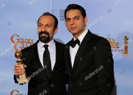 """Asghar Farhad, Peyman Moadi Director Asghar Farhad, left, and actor Peyman Moadi pose backstage with the award for Best Foreign Language Film for """"A Separation"""" during the 69th Annual Golden Globe Awards, in Los Angeles"""