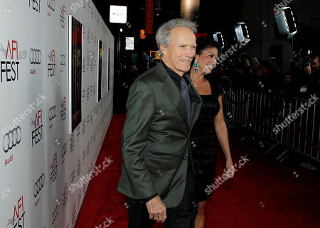 """Clint Eastwood, Dina Eastwood Director Clint Eastwood, left, and his wife, Dina, arrive at the premiere of """"J. Edgar"""" during the Opening Night Gala of AFI FEST 2011 in Los Angeles, . """"J. Edgar"""" opens in theaters Nov. 9, 2011"""
