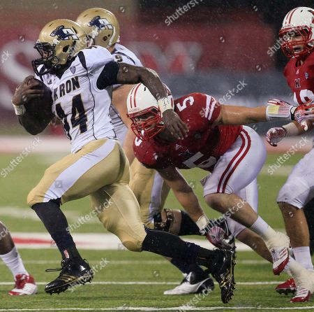 Jawon Chisholm, Ryan Kennedy Akron running back Jawon Chisholm (44) runs past Miami (Ohio) linebacker Ryan Kennedy (5) in the first half of an NCAA college football game, in Oxford, Ohio