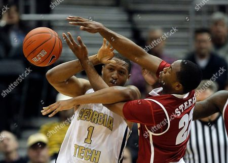 Andrew Steele, Julian Royal Georgia Tech forward Julian Royal (1) and Alabama guard Andrew Steele (22) fight for a loose ball in the second half of an NCAA college basketball game in Atlanta