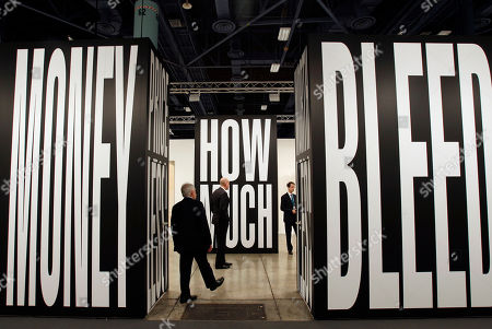 An artwork by Barbara Kruger is exhibited by the Mary Boone Gallery during the Vernissage Art Basel Miami Beach, in Miami Beach, Fla