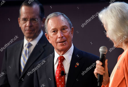 """Michael Bloomberg, Michael Mullen, Tenley Albright New York Mayor Michael Bloomberg, center, and former chairman of the Joint Chiefs of Staff, retired U.S. Navy Adm. Michael Mullen, left, are introduced to an audience by Massachusetts Institute of Technology Collaborative Initiatives Director Tenley Albright, right, during an event on the schools campus called """"New Models 5 - Breaking Log Jams,"""" in Cambridge, Mass"""