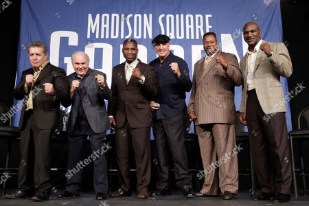 Vito Antuofermo, Carlos Ortiz, Marvis Frazier, Gerry Cooney, Larry Holmes, Evander Holyfield Boxers luminaries, from left, Vito Antuofermo, Carlos Ortiz, Marvis Frazier, Gerry Cooney, Larry Holmes, and Evander Holyfield pose for photographers during a round table discussion prior to the WBA super welterweight title fight between Miguel Cotto and Antonio Margarito, at Madison Square Garden in New York