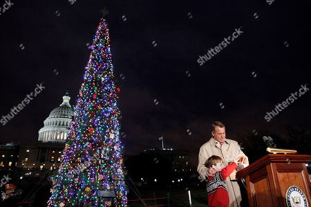 John Boehner, Johnny Crawford House Speaker John Boehner of Ohio, assisted by Johnny Crawford, 7, of Sonora, Calif., are seen during a lighting ceremony of the U.S. Capitol Christmas tree, in Washington