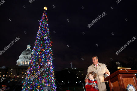 John Boehner, Johnny Crawford House Speaker John Boehner, R-Ohio, assisted by Johnny Crawford, 7, from Sonora, Calif., are seen during the lighting ceremony of the U.S. Capitol Christmas tree, in Washington