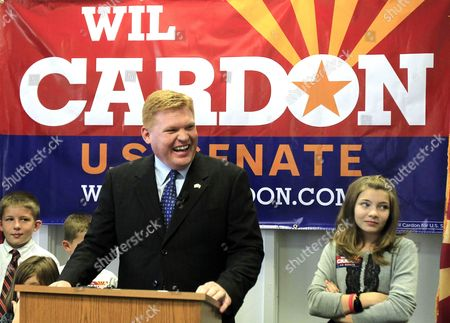 Stock Image of Wil Cardon, Rebecca Cardon, Parley Cardon Mesa, Ariz. businessman Wil Cardon, center, flanked by two of his five children, Rebecca Cardon, 11, right, and Parley Cardon, 10, begins his U.S. Senate statewide campaign, in Phoenix. Cardon has been campaigning for a few months now, but launched the opening of his campaign headquarters and campaign tour on Tuesday