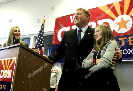 Wil Cardon, Nicole Cardon, Rebecca Cardon Mesa, Ariz. businessman Wil Cardon, center, puts his arm around daughter Rebecca Cardon, 11, right, as wife Nicole Cardon, left, smiles as Wil Cardon begins his U.S. Senate statewide campaign, in Phoenix. Cardon has been campaigning for a few months now, but launched the opening of his campaign headquarters and campaign tour on Tuesday