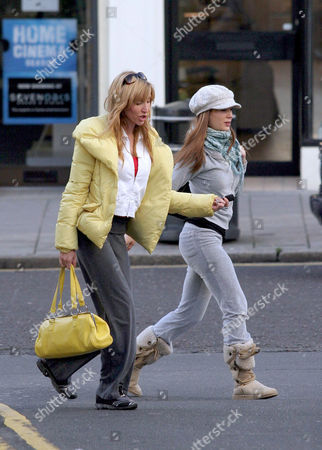 Heather Mills McCartney and nanny Sara Trumble. Her nanny wore Heather's trademark grey hat and Heather wore her favourite grey tracksuit bottoms