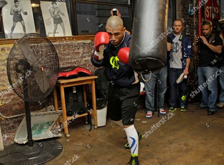 Miguel Cotto An autographed photo of boxer Jake LaMotta sits on the window sill as boxer Miguel Cotto, of Puerto Rico, works out with a heavy bag at Trinity Gym in New York, . Cotto is preparing to defend his WBA super welterweight title against Mexico's Antonio Margarito on Saturday, Dec. 3, at Madison Square Garden