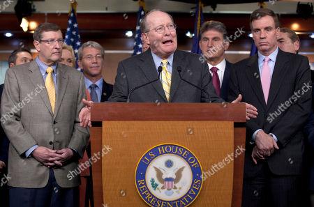 Kent Conrad, Joe Manchin, Mark Warner Sen. Lamar Alexander, R-Tenn., center, accompanied by Senate Budget Committee Chairman Kent Conrad, D-N.D., left, Sen. Joe Manchin, D-W.Va., second from right, Sen. Mark Warner, D-Va. right, and others, gestures during a news conference on Capitol Hill in Washington
