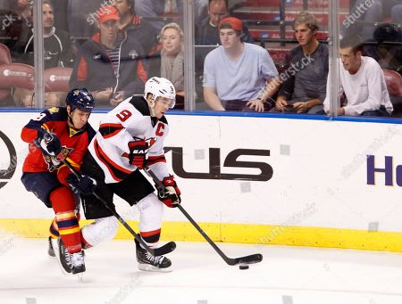 Stock Picture of Zach Parise, Stephen Weiss Florida Panthers center Stephen Weiss, left, and New Jersey Devils left wing Zach Parise battle for the puck during the second period of an NHL hockey game, in Sunrise