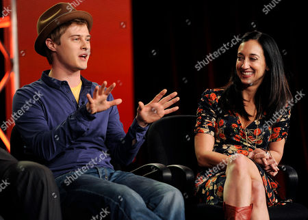 """Lucas Grabeel, Lizzy Weiss Lucas Grabeel, left, a cast member in the ABC Family series """"Switched at Birth,"""" takes part in a panel discussion on the show with the show's creator and executive producer Lizzy Weiss at the Disney ABC Television Critics Association Press Tour, in Pasadena, Calif"""
