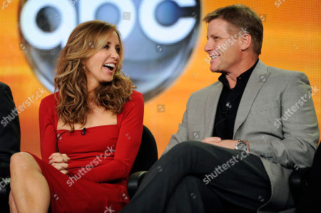 "Felicity Huffman, Doug Savant Felicity Huffman, left, and Doug Savant, cast members in the ABC series ""Desperate Housewives,"" share a laugh onstage during a panel discussion on the show at the Disney ABC Television Critics Association Press Tour, in Pasadena, Calif"