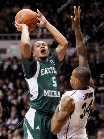 Derek Thompson, Jacob Lawson Eastern Michigan guard Derek Thompson hits a shot over Purdue forward Jacob Lawson in the second half of an NCAA college basketball game in West Lafayette, Ind., . Purdue defeated Eastern Michigan 61-36