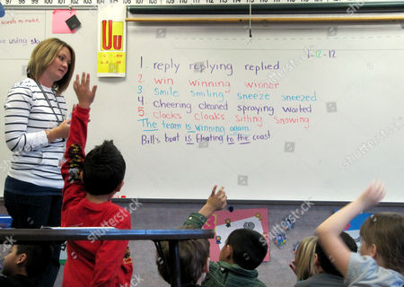 Jennifer Miller teaches a first-grade reading class at Sherman Elementary School in Nampa, Idaho. The Nampa School District plans to use money lawmakers set aside last year for classroom technology upgrades to buy new computers for students in first through fifth grades