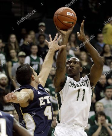 DeMario Mayfield, Adam Sollazzo Charlotte's DeMario Mayfield, right, shoots over East Tennessee State's Adam Sollazzo during the first half of an NCAA college basketball game in Charlotte, N.C