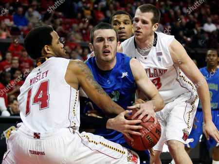 Brett Comer, Sean Mosley, John Auslander Florida Gulf Coast guard Brett Comer, center, fights for possession of the ball with Maryland guard Sean Mosley, left, and forward John Auslander in the first half of an NCAA college basketball game in College Park, Md