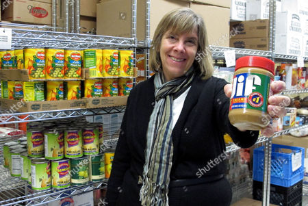 Stock Picture of Manager Kathy Kelly-Long holds a jar of peanut butter which is in short supply at the Broad Street Presbyterian Church food pantry in Columbus, Ohio. Food banks around the country say rising peanut butter prices are making it harder for them to provide one of their most-requested items this holiday season
