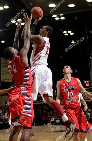 Josh Owens, Kevin Foster, Steven Shepp Stanford's Josh Owens (13) shoots over Fresno State's Kevin Foster (24) and Steven Shepp (12) during the first half of an NIT Season Tip-Off NCAA basketball game in Stanford, Calif