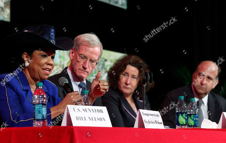 Ken Merten, Frederica Wilson, Tom Adams, Elizabeth Hogan U.S. Rep. Frederica Wilson, left, speaks as Tom Adams, second from left, Haiti Special Coordinator Dept. of State, Elizabeth Hogan, second from right, Director of Haiti Task Team USAID and U.S. ambassador to Haiti Ken Merten, rear, listen, at Miami Edison Middle School, during a to talk about what progress has been made in Haiti since the earthquake struck Jan. 12, 2010. Wilson, a Miami Democrat, said Thursday there are encouraging signs of progress in Haiti but the country needs more sustainable help from the U.S
