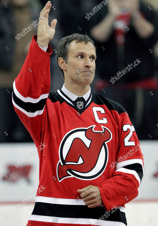 Scott Niedermayer Former New Jersey Devils player Scott Niedermayer waves during a ceremony in which the team retired his No. 27 jersey, in Newark, N.J. Niedermayer and Chris Chelios, along with forward Brendan Shanahan have been picked for the Hockey Hall of Fame