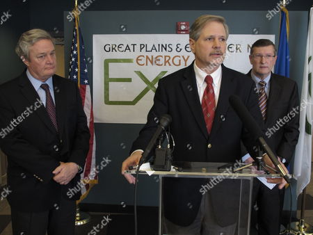 North Dakota U.S. Sen. John Hoeven, R-N.D., speaks at a news conference held in connection with the Great Plains and EmPower ND Energy Expo, in the National Energy Center of Excellence at Bismarck State College in Bismarck, N.D., as North Dakota Gov. Jack Dalrymple, left, and U.S. Sen. Kent Conrad, D-N.D., watch. Hoeven and Conrad said they hoped a pollution regulation dispute with the federal Environmental Protection Agency would be resolved in the state's favor