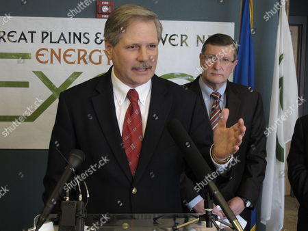 North Dakota U.S. Sen. John Hoeven, R-N.D., speaks at a news conference held in connection with the Great Plains and EmPower ND Energy Expo, in the National Energy Center of Excellence at Bismarck State College in Bismarck, N.D., as U.S. Sen. Kent Conrad, D-N.D., watches. Hoeven and Conrad said they hoped a pollution regulation dispute with the federal Environmental Protection Agency would be resolved in the state's favor
