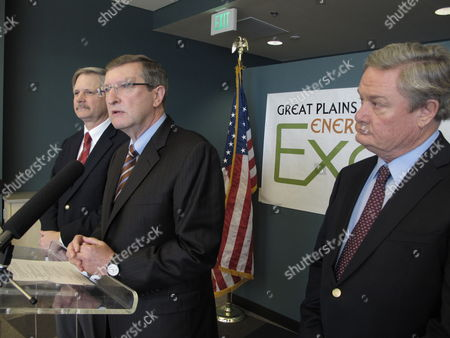 Sen. Kent Conrad, D-N.D., speaks at a news conference held in connection with the Great Plains and EmPower N.D. Energy Expo, in the National Energy Center of Excellence at Bismarck State College in Bismarck, N.D., as U.S. Sen. John Hoeven, R-N.D., left, and North Dakota Gov. Jack Dalrymple, right, watch. Hoeven and Conrad said they hoped a pollution regulation dispute with the federal Environmental Protection Agency would be resolved in the state's favor