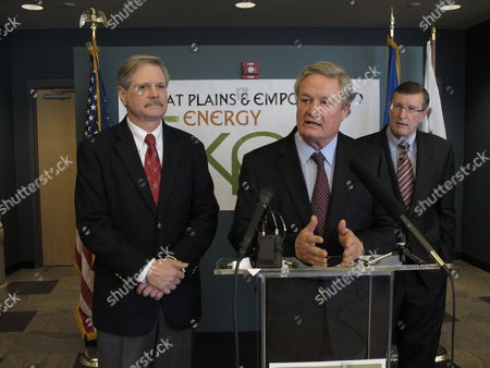 North Dakota Gov. Jack Dalrymple speaks at a news conference held in connection with the Great Plains and EmPower ND Energy Expo, in the National Energy Center of Excellence at Bismarck State College in Bismarck, N.D., as U.S. Sen. John Hoeven, R-N.D., left, and U.S. Sen. Kent Conrad, D-N.D., right, watch. Hoeven and Conrad said they hoped a pollution regulation dispute with the federal Environmental Protection Agency would be resolved in the state's favor