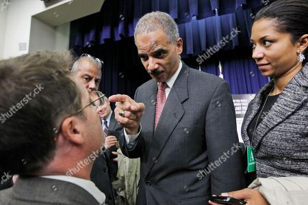 Eric Holder, Neil Munro Attorney General Eric Holder points at Daily Caller reporter Neil Munro after Munro asked Holder about calls for his resignation over an investigation of arms traffickers called Operation Fast and Furious after an event on counterfeit goods at the Eisenhower Executive Office Building across from the White House in Washington