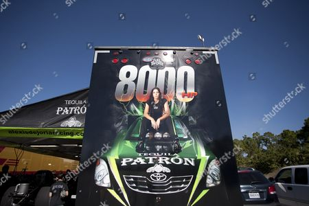 Alexis DeJoria Alexis DeJoria's photo decorates the back of her haul trailer at a racetrack in Jupiter, Fla. She is a tattooed mom, an heiress to a billion-dollar empire, and she has been drag racing competitively since 2005. DeJoria, 34, is a ranked National Hot Rod Association driver and the second woman to win a National event in funny car