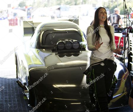 Stock Photo of Alexis Dejoria Alexi DeJoria talks about her racing career in Jupiter, Fla. She is a tattooed mom, an heiress to a billion-dollar empire, and she has been drag racing competitively since 2005. DeJoria, 34, is a ranked National Hot Rod Association driver and the second woman to win a National event in funny car